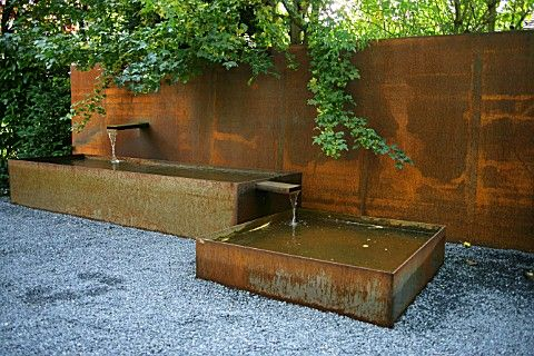 Corten steel fountain in modern garden design garden interior design garden designs