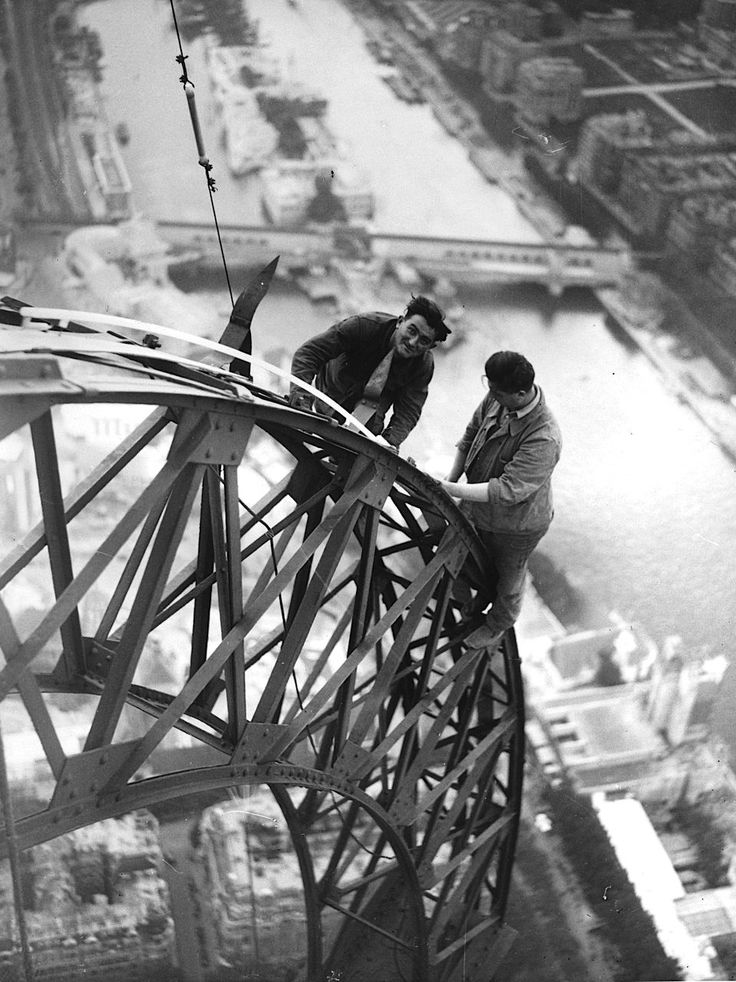 Lights are installed by electricians on the Eiffel tower for the Paris Exhibition. 1937. - Imgur