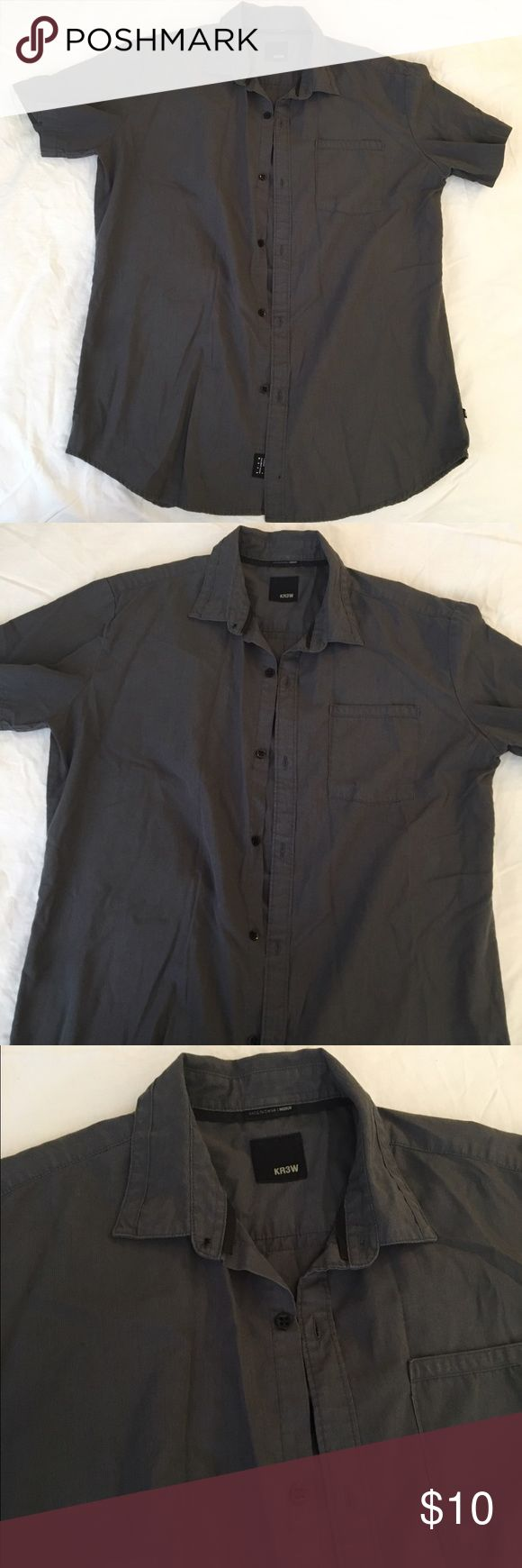 Mens Krew Short Slv Button-Up Size Large, as is in photo. Color is almost black, like a gun-metal charcoal/black. Great condition. Has a small little smudge/discoloration in corner of right sleeve-photographed(last photo). Krew Tops Button Down Shirts