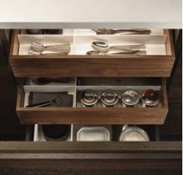 POLIFORM VARENNA_Inner drawers in walnut c. with equipments in corian, inner led lighting. Personalised fl ush built-in sink in steel Varenna by Barazza.