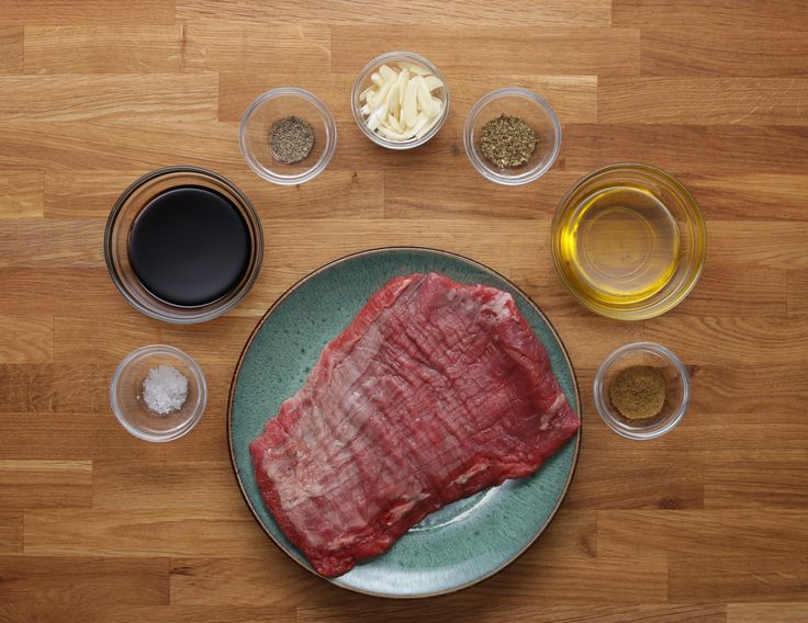 Here is what you'll need! Ingredients 1 pound flank steak or skirt steak Marinade ½ cup soy sauce 4 cloves garlic, sliced ¼ cup olive oil 1 teaspoon salt ½ t...