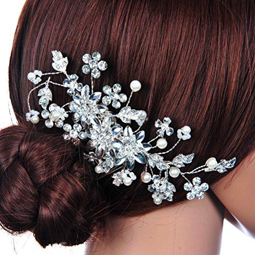 We have a range of beautiful sparkly hair combs for your special day!  http://amzn.to/2lj9uVW