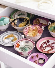 Genious!!! pinner said, I did this in a large dresser drawer and love it. Line drawer with velvet or felt, arrange random china pieces to organize jewelry in.  Cute vintage teacups are perfect to drape earrings in. Perfect when you have too much for a display rack and doesnt get tangled like in a jewelry box.