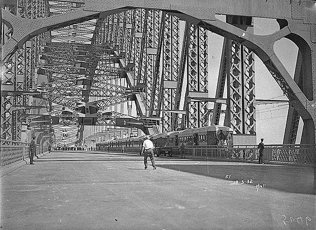 Harbour Bridge with first electric train before official opening, Sydney Harbour Bridge Celebrations, 1932 / photographed by Hall & Co. Find more detailed information about this image: http://acms.sl.nsw.gov.au/item/itemDetailPaged.aspx?itemID=61731 From the collection of the State Library of New South Wales www.sl.nsw.gov.au