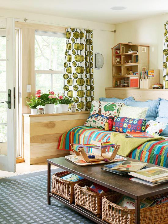 This kid friendly space contrasts neutral walls with bold patterned fabrics and bright accessories. More living room design ideas: http://www.bhg.com/rooms/living-room/makeovers/living-room-decorating-ideas/?socsrc=bhgpin082413kidhaven=15