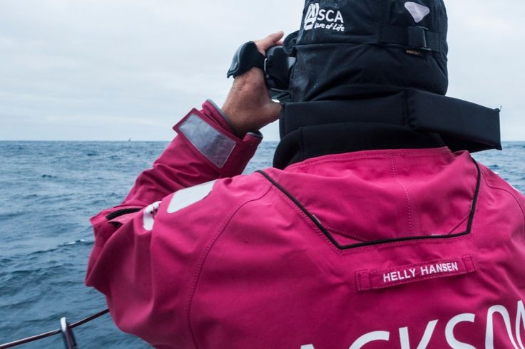 March 22, 2015. Leg 5 to Itajai onboard Team SCA. Stacey Jackson with the binoculars pointing at Dongfeng at the horizon - Anna-Lena Elled / Team SCA/ Volvo Ocean Race
