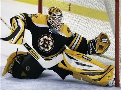 Tim Thomas Glove Save. Awesome photo!