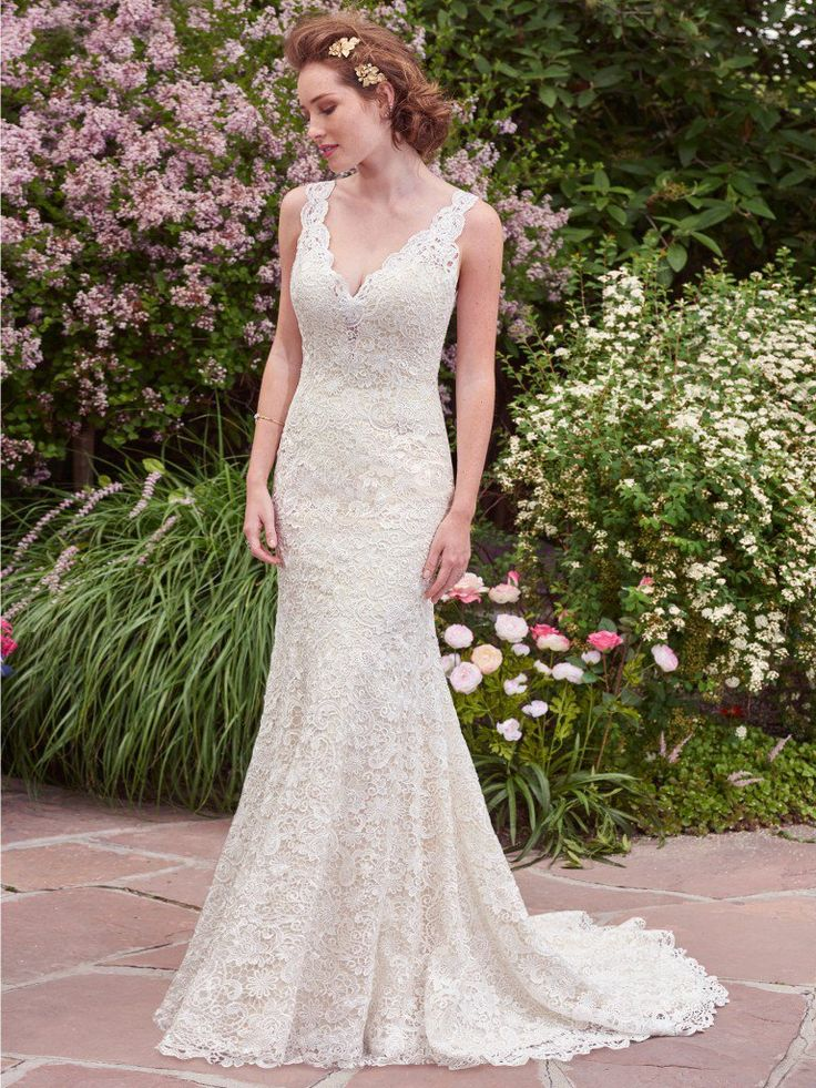 Rebecca Ingram - HOPE, Romantic and vintage-inspired, this allover-lace fit-and-flare features an illusion plunging neckline and scalloped edging. A double-keyhole back adds a touch of alluring elegance to this lace wedding dress. Finished with covered buttons over zipper closure.