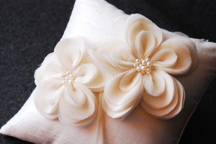 this etsy mom and daughter make handcrafted ring bearer pillows, garters, etc.
