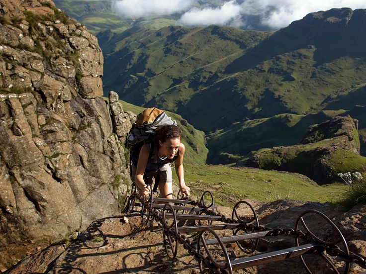 Photo: A woman climbs a chain ladder along the North Drakensberg Traverse, South Africa.