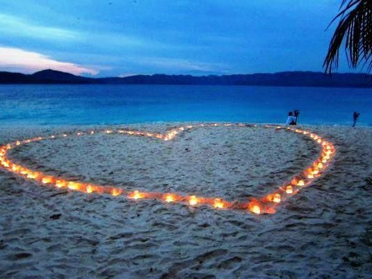 Place (battery operated) candles in the shape of a heart for your beach wedding! #heart #wedding #beach.  More ideas see www.paperlesswedding.co.uk/blog