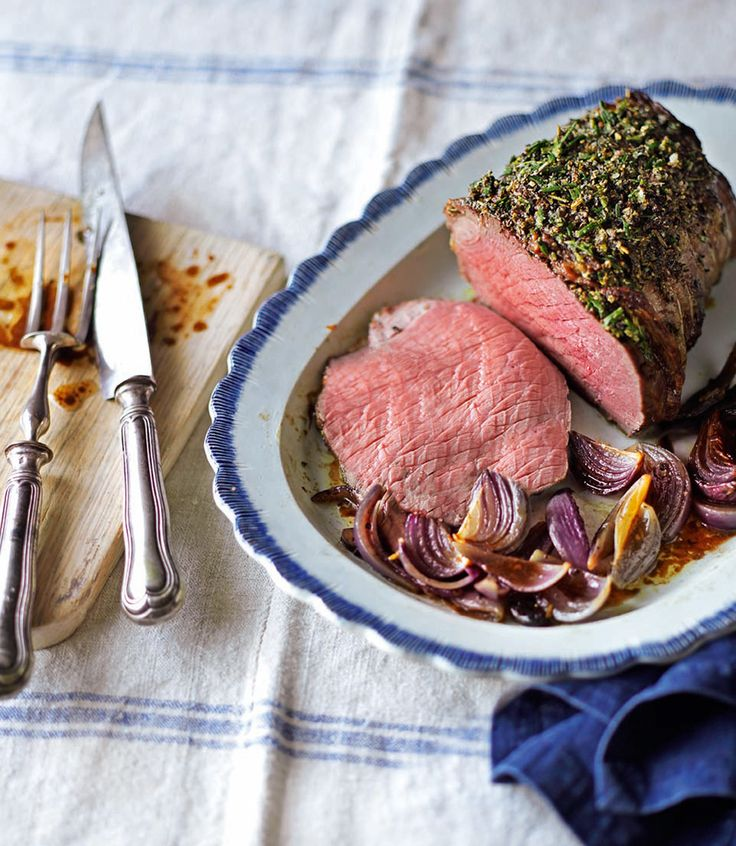Make your Sunday roast even more special with this slow-roast beef with a pepper and rosemary crust and Guinness onions.