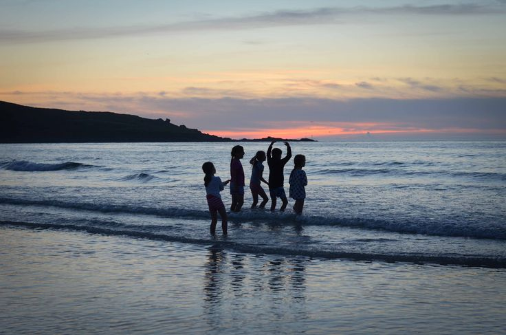 Family fun at sunset on Carbis Bay beach in St Ives, Cornwall