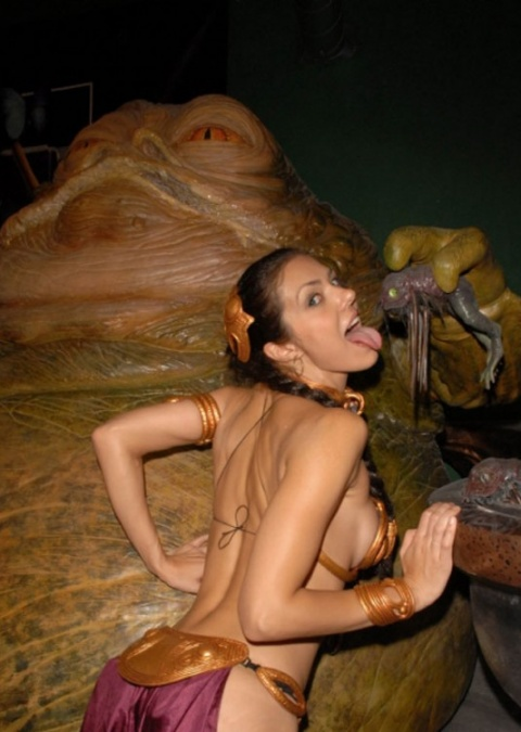 Slave Leia teases the viewer.