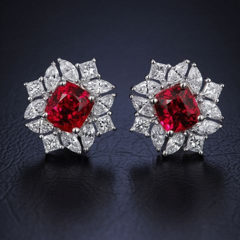 Center stone about 1ct each, burma red spinels and eye clean