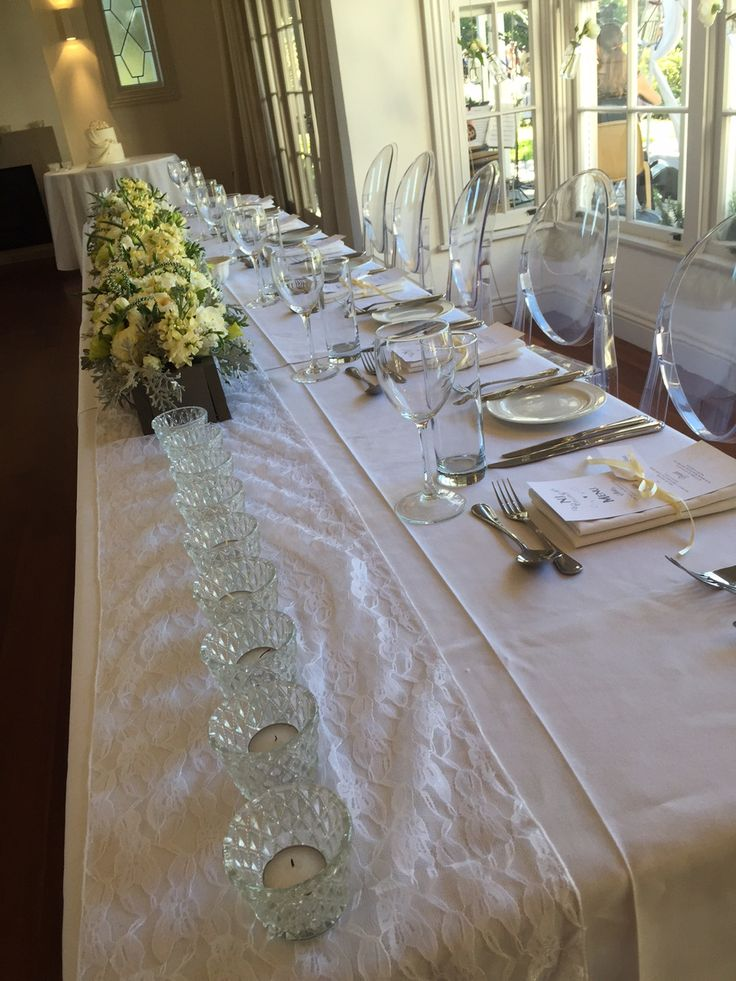 Head Table - White lace with the wall of flowers and candles