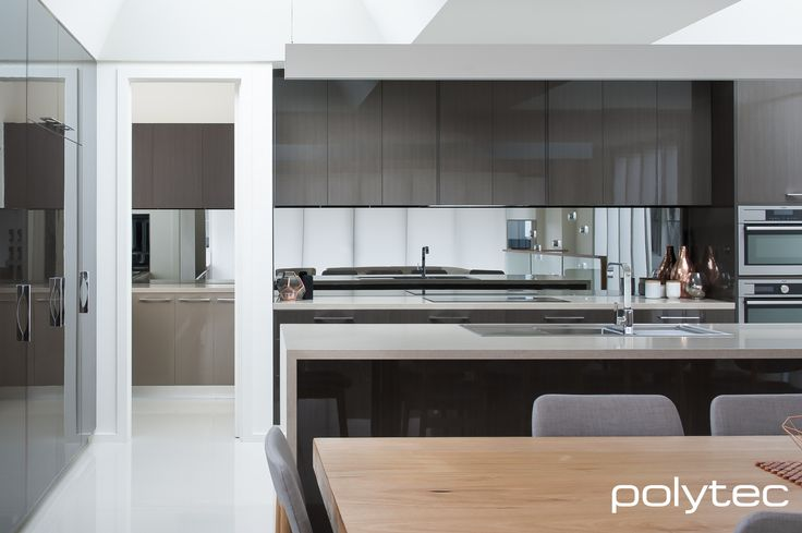 polytec - Doors and drawers in CREATEC Shannon Oak. Butler pantry base drawers in CREATEC Malt.