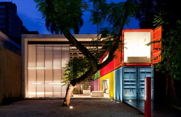This painted fancy pad by Brazillian Architect Marcio Kogan doesn't try to hide the containers. | 23 Surprisingly Gorgeous Homes Made From Shipping Containers