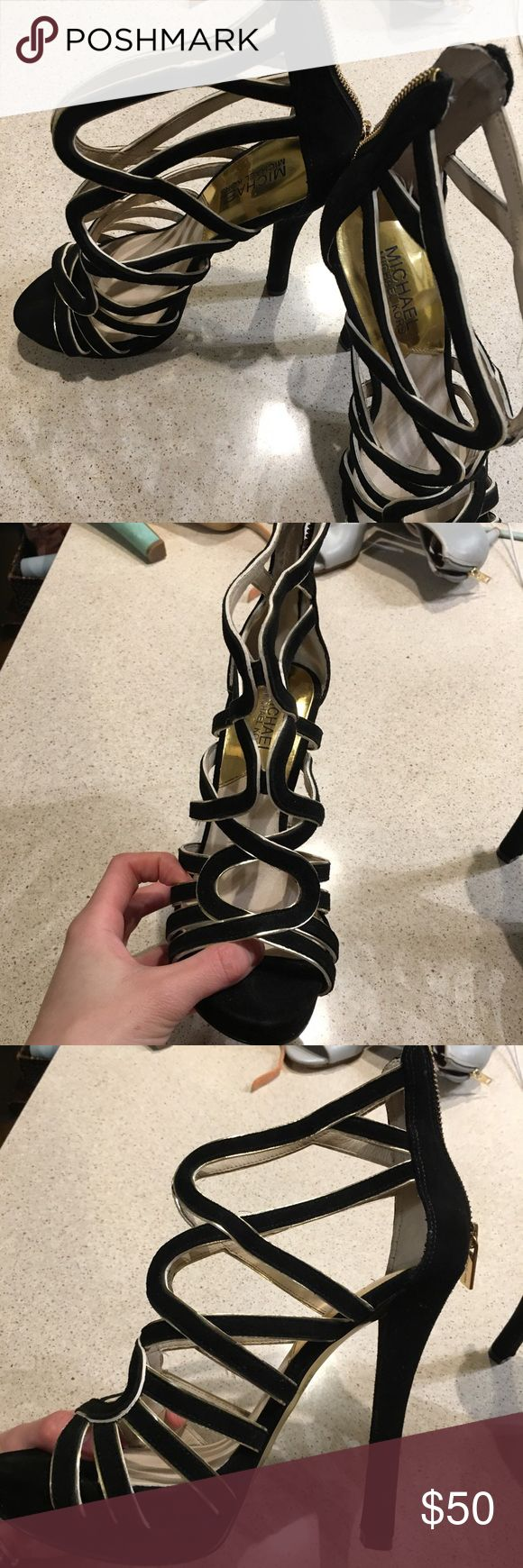 Michael kors black/gold leather heels Michael kors black/gold leather heels, size 7 I just posted lots of items today, take a look to see if you like other items too. I can bundle sell them. Price is negotiable! So just ask me, maybe we can agree to a price! Michael Kors Shoes Heels