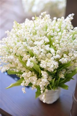 Grace Kelly and Elizabeth Taylor (all eight times) made Lily of the Valley one of the most popular flowers requested in a bridal bouquet.  I love them in abundance like this.