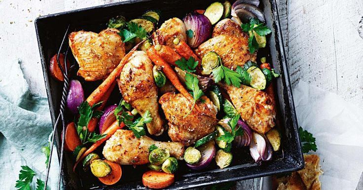 For a hearty winter meal try this flavoursome chicken tray bake, served with seasonal veggies and toasted pita pockets.
