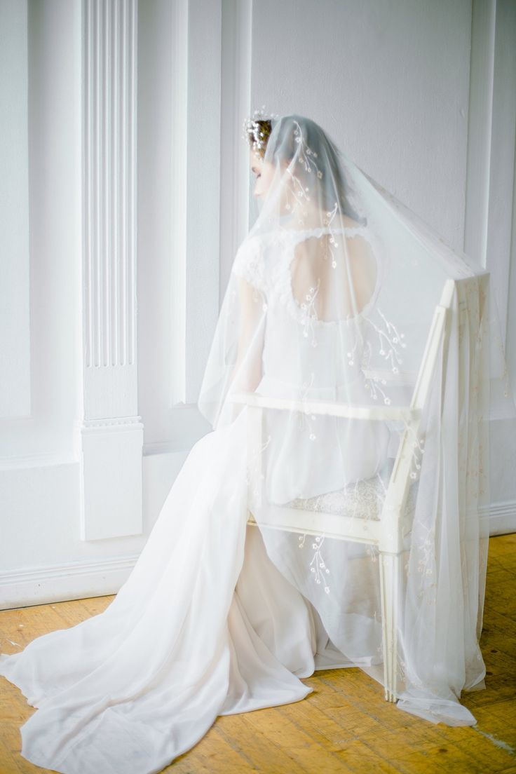 Off-white waltz wedding veil with floral ornament embroidery