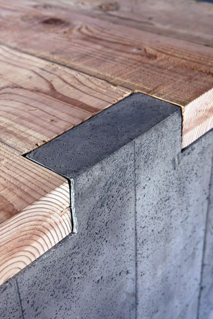 Wood & concrete tongue & groove.