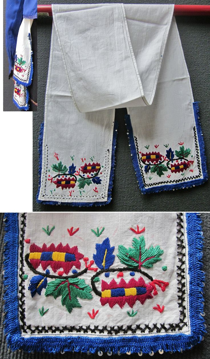 An 'uckur' (woman's waistband/sash) with embroidered ends.  From the Turkish villages in the northern part of the Burgas province (Bulgaria), mid-20th century.  The embroidery is only partly 'two-sided' (identical on both sides of the fabric) and is executed in cotton on linen.  The waistband's ends are edged with a blue 'pullu oyası' (Turkish lace combined with metal sequins).  (Inv.nr. brdw045 - Kavak Costume Collection - Antwerpen/Belgium).
