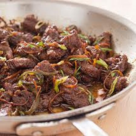 America's Test Kitchen recipe for Crispy Orange Beef ~ cornstarch dusted flap meat then stashed in the freezer is the key to crispy separated beef strips