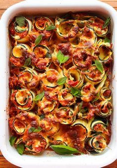 Vegetarian Zucchini Lasagna Rolls filled with spinach, ricotta, and a chunky homemade marinara sauce.
