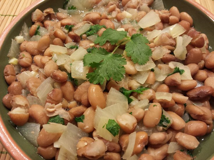 This recipe uses onion, garlic and cilantro to flavor the pinto beans instead of peppers which are in the nightshade family.