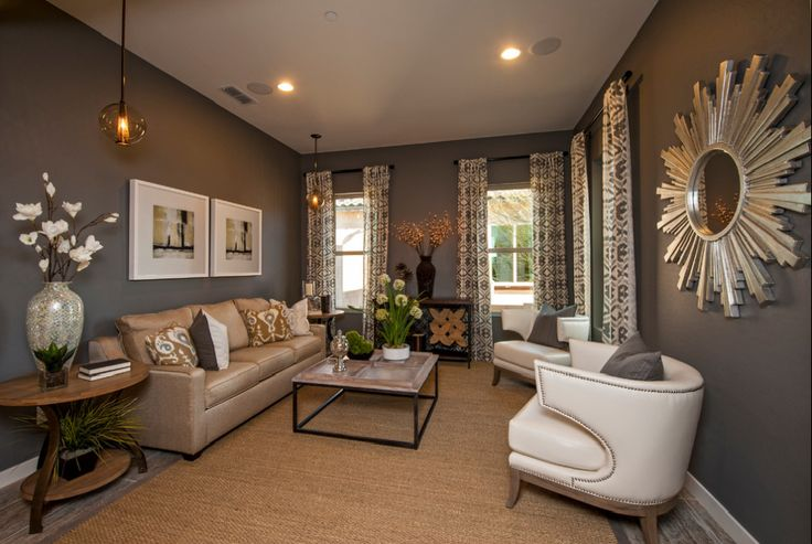 LIVING ROOM: Taupe walls, leather couches, light/plush accents