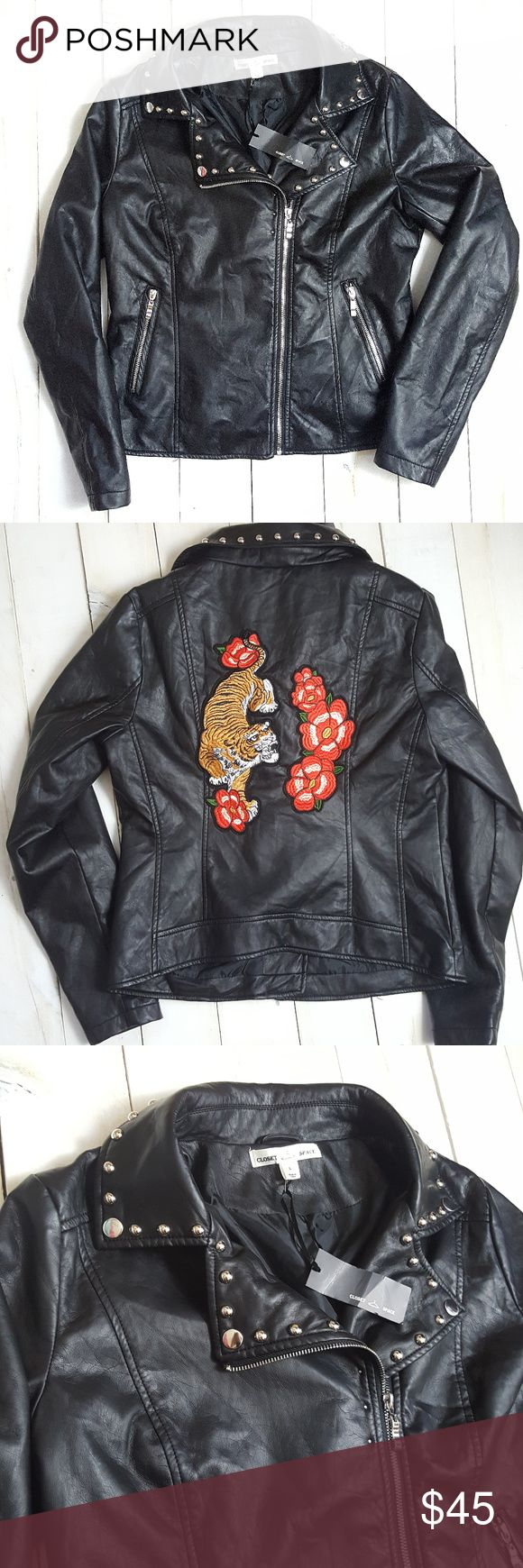 "Faux Leather Black Motorcycle Jacket Womens Large Condition: New with tags  Size: Large  Chest: 20""  Sleeve: 25""  Length: 25""  ~  All items are inspected for flaws and are stated as such in the listing. Pre-owned items are washed and are guaranteed pet/smoke-free.  Customer satisfaction is very important, so if you ever have an issue with your order, please feel free to message me and I will be happy to assist you.  If your item does not fit or you are not satisfied, you may return it within…"