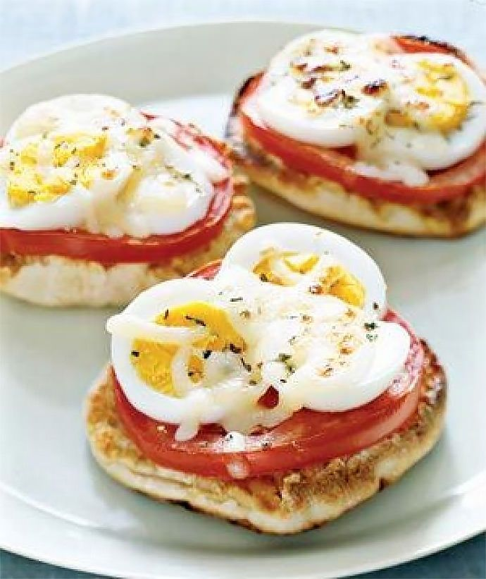 Breakfast Sandwich Recipe: English Muffin Egg Pizzas (via RealSimple)