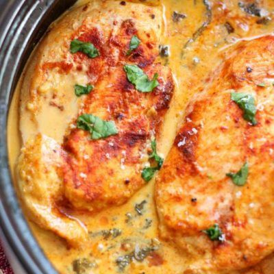 This is a picture of a lemon butter chicken in a baking dish. Recipe at recipesworthrepeating.com