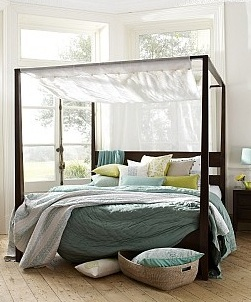 Wooden 4 poster bed with mosquito net