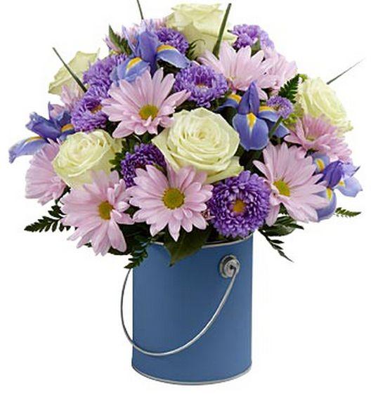 Ilumina su mundo. Arreglo de flores púrpura.   http://azapregalos.com/florerias/
