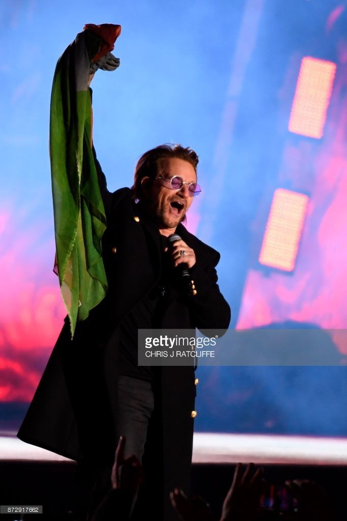 Bono of Irish rock band U2 performs with his band on stage in Trafalgar Square in central London on November 11, 2017 during the 'MTV Presents Trafalgar Square' ahead of the MTV Europe Music Awards (EMAs) on November 12. / AFP PHOTO / Chris J Ratcliffe