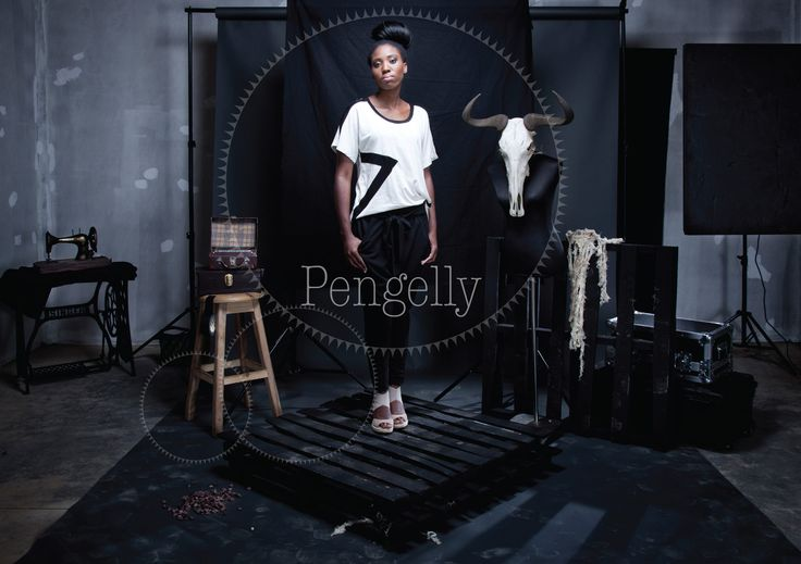 Ladies oatmeal melange and black slouchy geometric high low tee with black viscose harem knit pants. For more information visit: https://www.facebook.com/pengellyclothing or https://www.pengelly.co.za