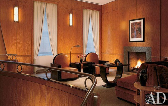 """""""She's a sailor, and the entire house is about the great ocean liners of the 1930s,"""" says Naomi Leff of Joan Lappin's Manhattan townhouse, which Leff designed. Anigre paneling and Art Deco furnishings embellish the theme. A Cubist work by Jeanne Rij-Rousseau hangs in the living area flanked by a pair of Macassar-ebony armchairs and a curvaceous '30s U table. (October 1997)"""