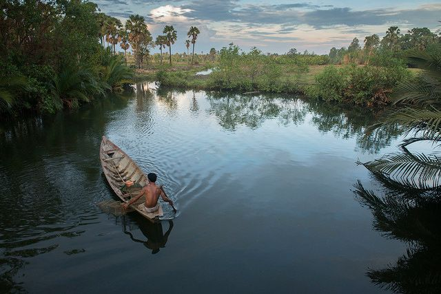 Photo of the Day: Fishing on the Calm Waters of Cambodia | A fisherman sits patiently for the catch of the day in Kampot, #Cambodia on April 29, 2014. (Brett Davies/Flickr)