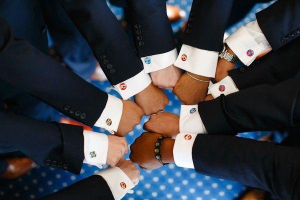 Groomsmen idea - the groomsmen wore cufflinks representing their favorite sports teams {Will King Photography}