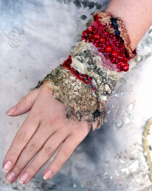 cranberries in snow, tribal influenced romantic wrist wrap from antique lace and nuno felt. $115.00, via Etsy.