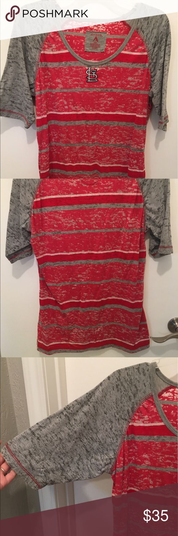 St. Louis Cardinals Burnout 3/4 sleeve T STL Cardinals Burnout 3/4 sleeve T-Shirt. Never worn, tags removed. Red with grey sleeves. Size L, but fits like a M. Antigua Tops Tees - Short Sleeve