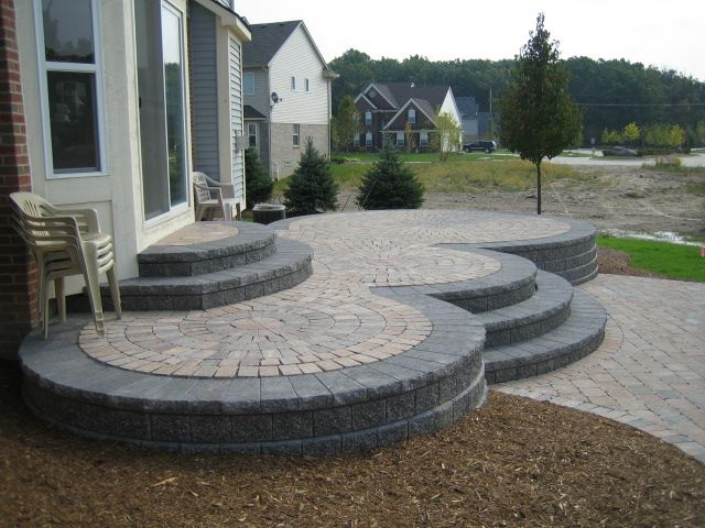 Elevated patio designs history of brick paver raised for Fireplace on raised deck