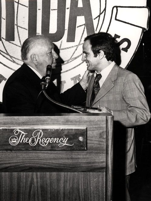Alfred Hitchcock gives François Truffaut an award for Best Foreign Film for La Nuit Américaine, 1974.