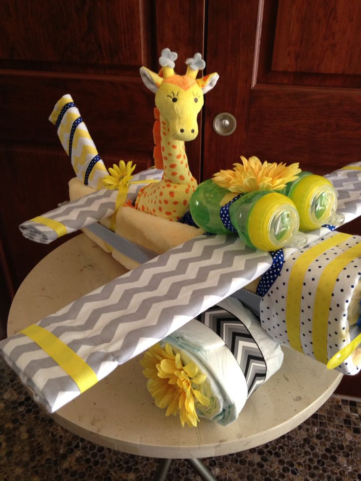 Ray of Sunshine Airplane Diaper Cake www.TopsyTurvyDiaperCake.com - washcloth favors, washcloth animals, diaper cakes, and baby shower gifts