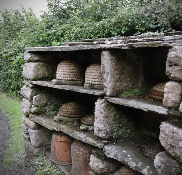 love the outdoor stone shelving!!!  (love the bee skeps, too)!