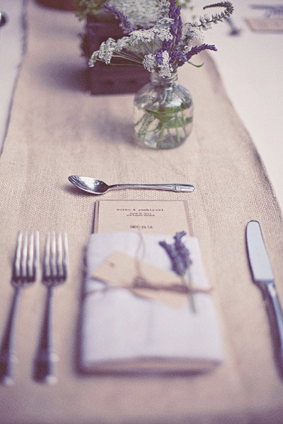 Like the menu folded in napkin and single flower.  String/twine might be nice too.