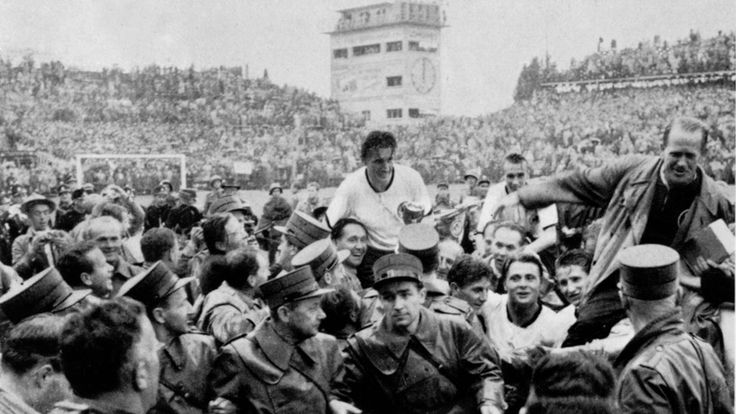 West Germany's captain and coach, Fritz Walter and Sepp Herberger, are carried aloft following their reverse of Hungary in the 1954 FIFA World Cup Switzerland™ Final.